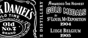 Detail of Jack Daniel's label saying: Awarded the Highest Gold Medals at St. Louis, Mo. Exposition 1904, Leige Belgium 1905...