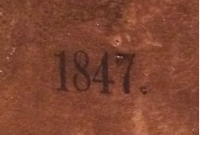 Extreme closeup showing 1847 on label